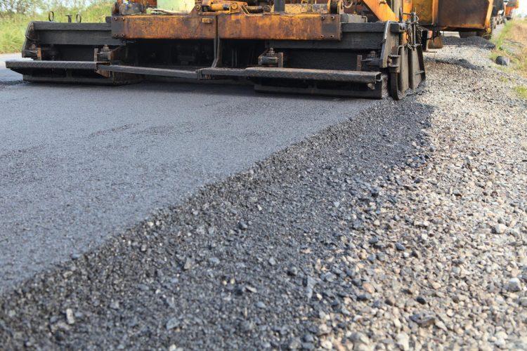 A vehicle working on asphalt paving