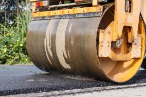 a machine roller smoothing asphalt