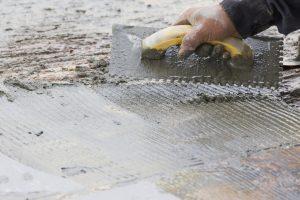 worker paving concrete
